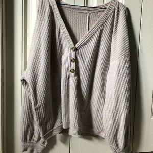 Long-sleeve, buttoned shirt